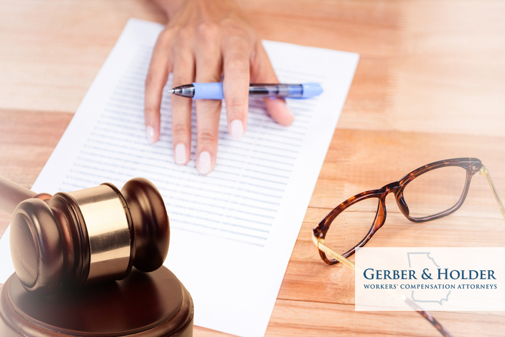 digital composite of Gavel on desk with glasses and hand writing